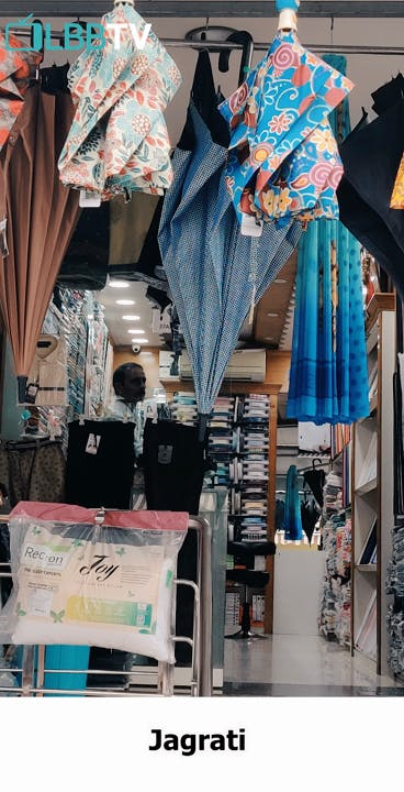 Boutique,Textile,Room,Building,Bazaar,Shopping,Window,Outlet store,City,Style