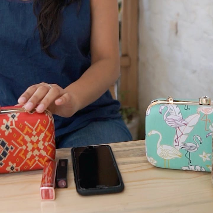 Wallet,Coin purse,Handbag,Bag,Pink,Fashion accessory,Design,Material property,Hand,Pattern