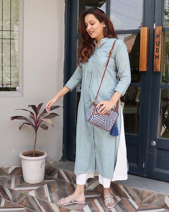 Clothing,Blue,Outerwear,Street fashion,Fashion,Waist,Footwear,Cardigan,Sleeve,Dress