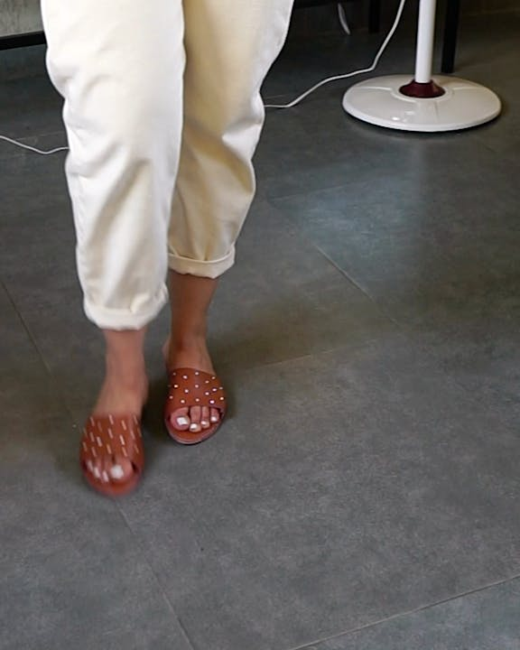 White,Footwear,Leg,Floor,Human leg,Shoe,Foot,Ankle,Flooring,Sandal