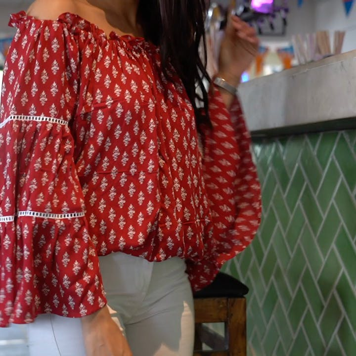 Clothing,Red,Shoulder,Pattern,Maroon,Outerwear,Design,Joint,Sleeve,Textile