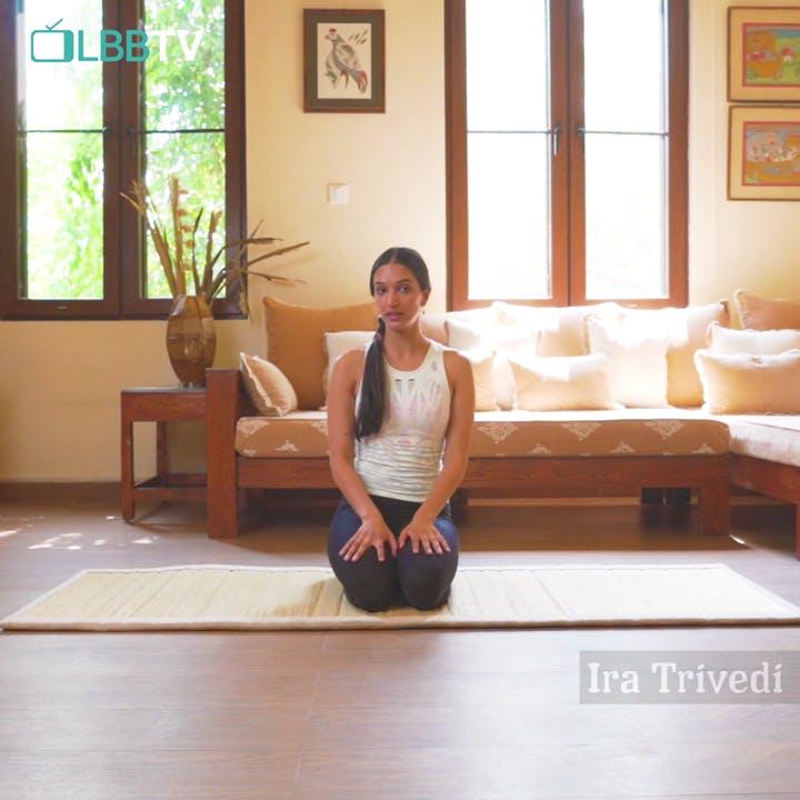 Physical fitness,Yoga,Floor,Flooring,Sitting,Hardwood,Room,Leg,Yoga mat,Pilates