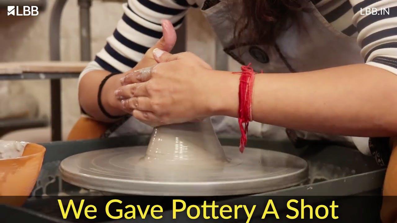 Potter's wheel,Wheel,Auto part,Automotive wheel system,Machine,Pottery,Hand,Finger,Nail,Clay