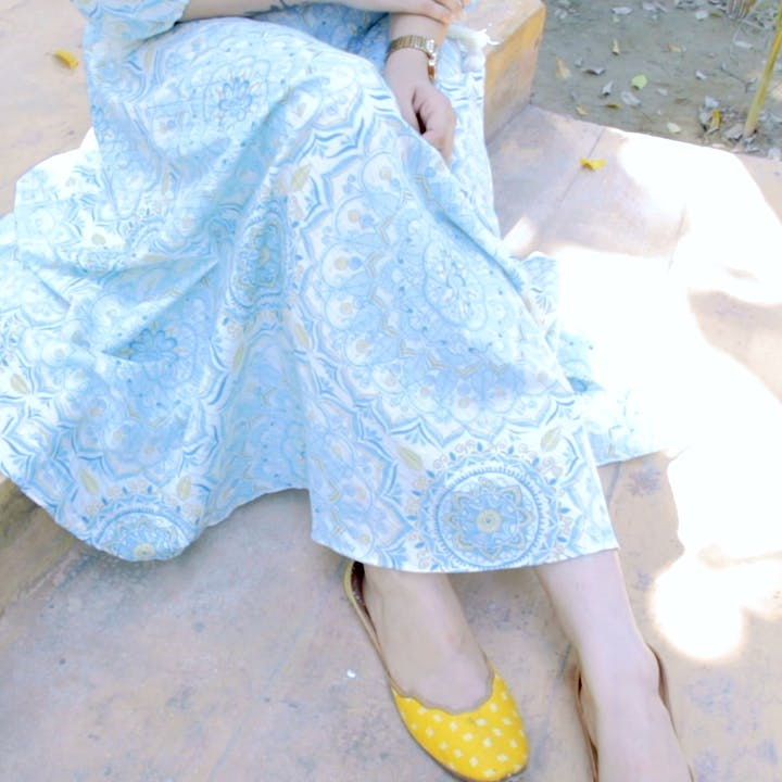White,Blue,Clothing,Yellow,Footwear,Fashion,Human leg,Leg,Dress,Denim