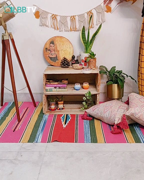 Room,Shelf,Furniture,Orange,Interior design,Living room,Table,Pink,Floor,Shelving