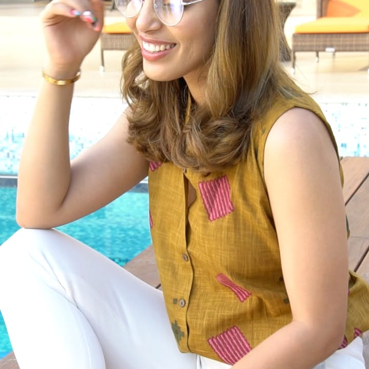 Clothing,Yellow,Beauty,Hairstyle,Arm,Long hair,Eyewear,Lip,Neck,Smile