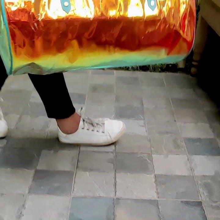 Floor,Orange,Flooring,Leg,Yellow,Tile,Shoe,Foot