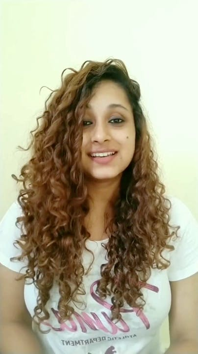 Hair,Hairstyle,Face,Ringlet,Eyebrow,Blond,Brown hair,Long hair,Chin,Forehead