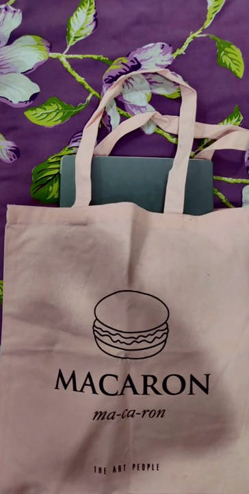 Product,Purple,Textile,Sleeve,Bag,Font,Paper bag,Material property,T-shirt,Packaging and labeling