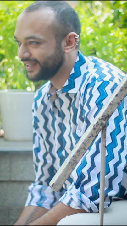 Beard,Blue,Houseplant,Flowerpot,Plant,Smile,Street fashion,Electric blue,Grass,Formal wear