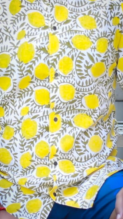 Flower,Textile,Organism,Yellow,Font,Petal,Art,Pattern,Circle,Symmetry