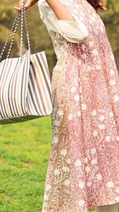 Outerwear,One-piece garment,Dress,Textile,Sleeve,Day dress,Pink,Grass,Plant,Waist